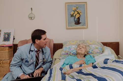 Dr. Thomas Cornwell with a patient, Mary Hanrahan